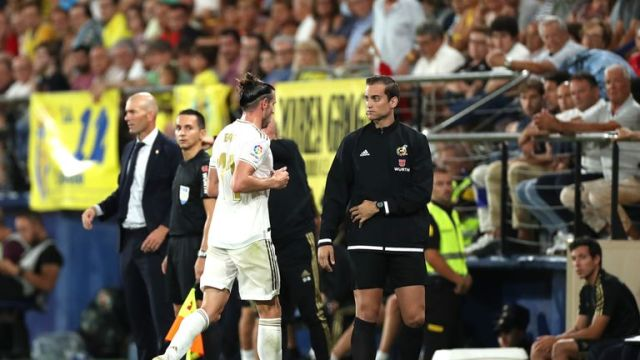 Bale leaves the field after being sent off