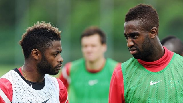 Alex Song and Johan Djourou, pictured during their time at Arsenal, are among nine players to be dismissed by FC Sion