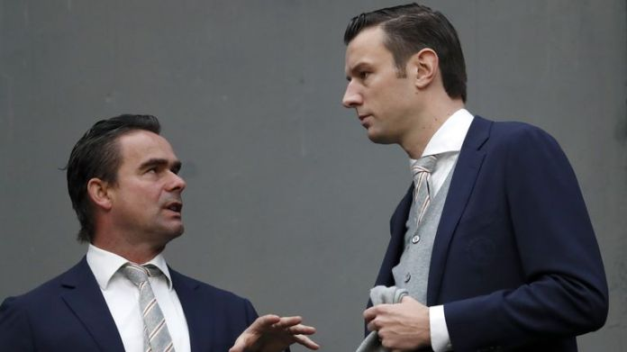 Ajax football director Marc Overmars (left) called for the abandonment of Eredivisie
