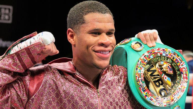 Devin Haney celebrates after defending his WBC lightweight belt