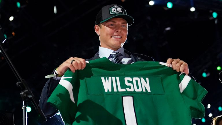 Zach Wilson gets used to his new colours after being selected by the New York Jets (AP Photo/Tony Dejak)
