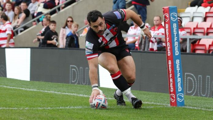 Salford Red Devils' Rhys Williams scores their first try