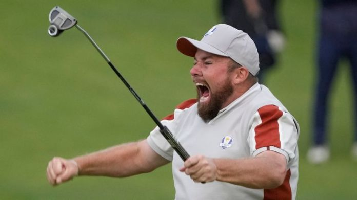 Shane Lowry celebrates after holing his match-winning putt at the 18th