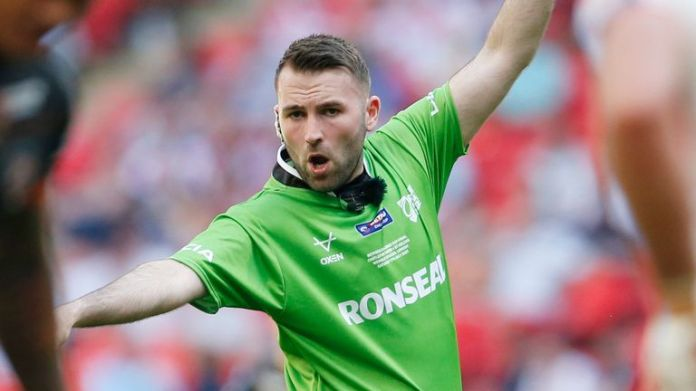 Referee Liam Moore takes charge of this year's Grand Final