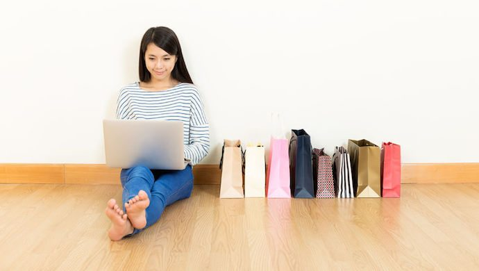 27506459 - asia woman online shopping at home
