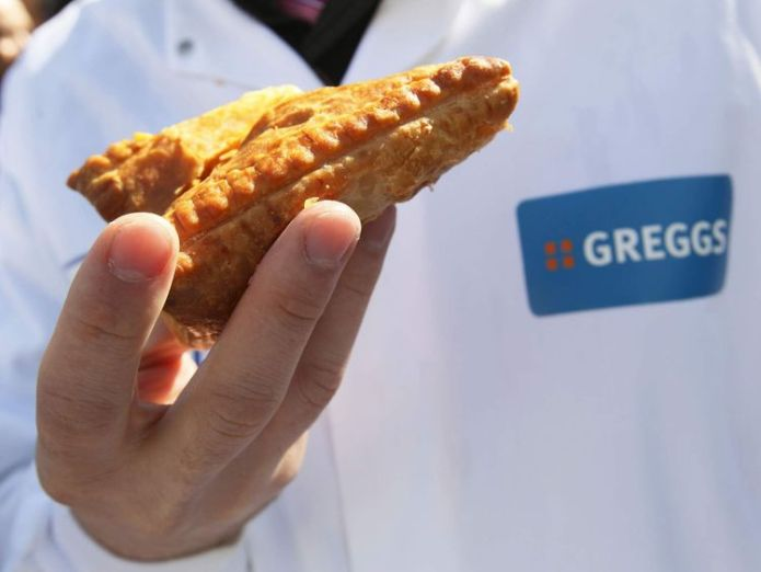 An employee of Greggs bakery holds a pasty  Greggs on a roll despite hit from summer heatwave 143416562 1 2048x1536 3398555
