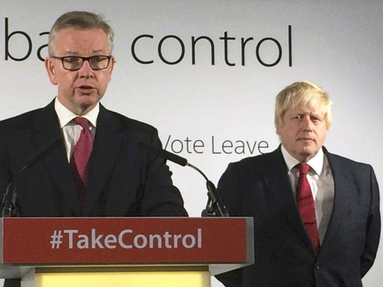 British Attorney General Michael Gove speaks while Boris Johnson, the campaign leader, listens at the group's headquarters in London