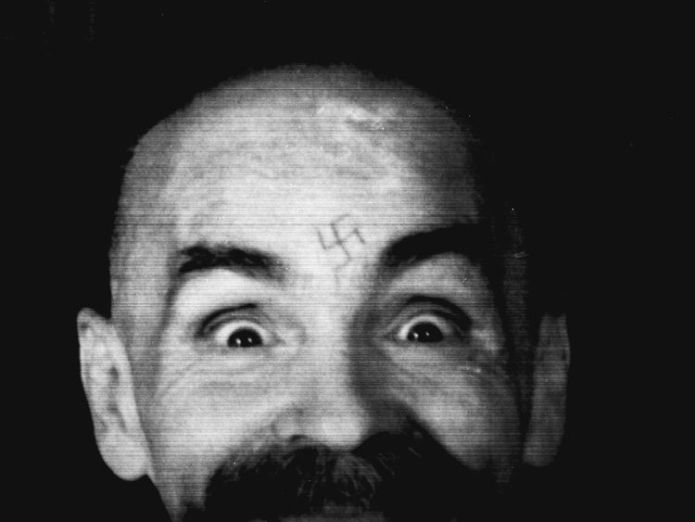Charles Manson photographed in 1989 as he is led to his cell after an interview with Reuters  First look at Margot Robbie as murdered actress Sharon Tate 5e403b162da68070b1b8d7652f6d9e636a709606824460f82bf9bfaae5e5eb04 3749735