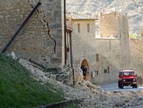 A giant crack down the wall of homes in  Norcia