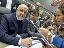 Iran's Oil Minister Bijan Zangeneh (L) talks with journalists as he attends a meeting of the Organization of the Petroleum Exporting Countries, OPEC, at the OPEC headquarters in Vienna, Austria on November 30, 2016. OPEC sought to defy expectations and finalise a deal reducing its oil output for the first time in eight years, in an effort to boost painfully low crude prices