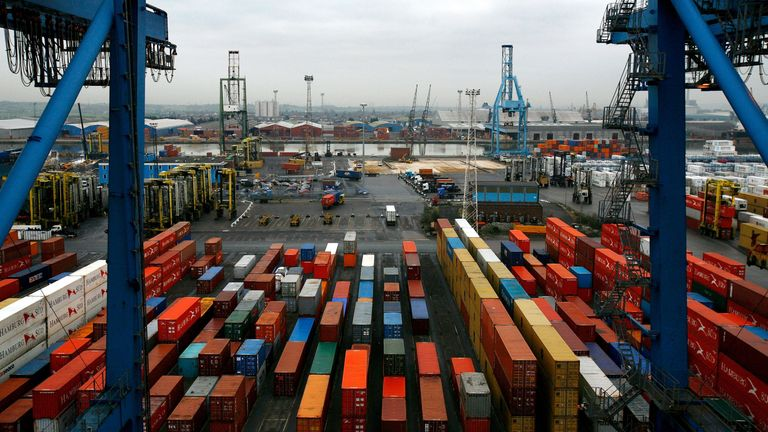 Ship freight containers sit on Tilbury Dock