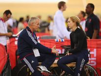 Laura Trott speaks with then technical director Shane Sutton at a competition in 2014
