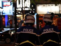 Police officers block the access to the Champs Elysees