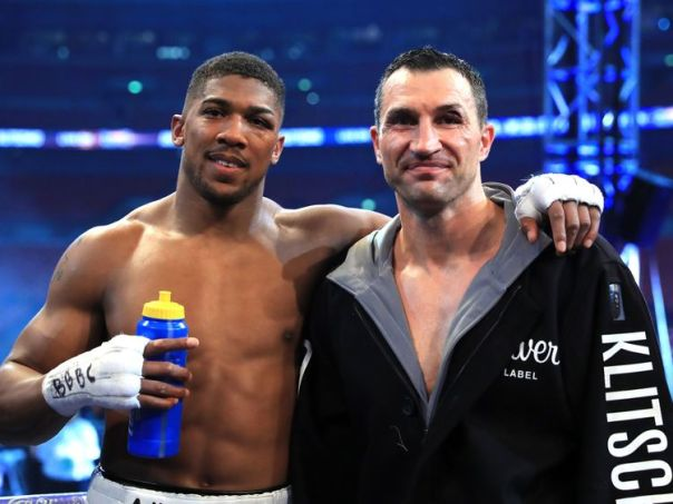 Anthony Joshua stands with Wladimir Klitschko following the IBF, WBA and IBO Heavyweight World Title bout
