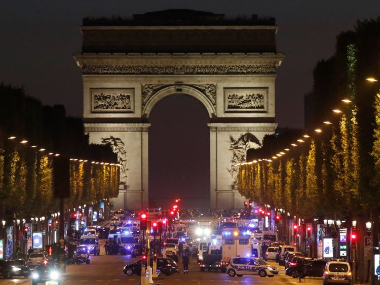 Police vehicles seen on the Champs-Elysees, near the Arc de Tiomphe