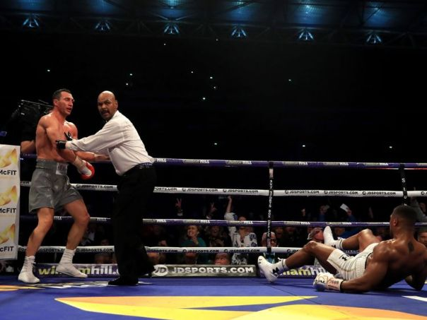 Anthony Joshua and Wladimir Klitschko in action during the IBF, WBA and IBO Heavyweight World Title bout at Wembley Stadium