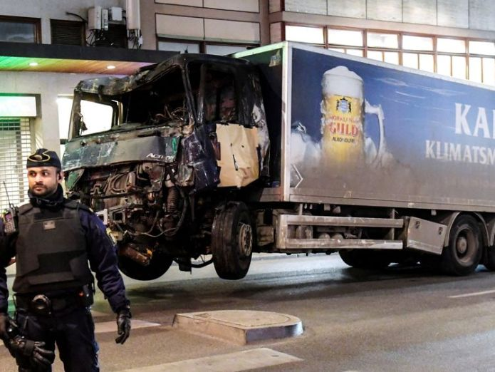 A truck tows away the hijacked lorry which struck pedestrians and crashed into a department store Sweden lorry attacker who killed shoppers wanted to build caliphate Sweden lorry attacker who killed shoppers wanted to build caliphate e19b7c69f21ad6794c91ccb54a46fca90fb5499c2c8404eb0a440eafc3781c58 3926260