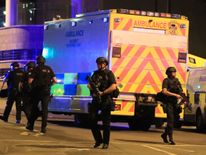 Armed police at Manchester Arena after reports of an explosion during an Ariana Grande gig