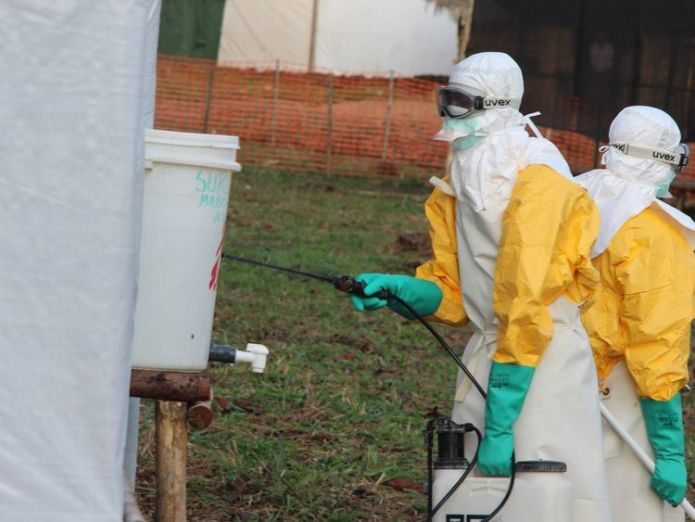 Hygienists wearing protective suits disinfect the toilets of the Ebola treatment centre in Lokolia, on October 5, 2014 Two cases of Ebola confirmed in the Democratic Republic of the Congo Two cases of Ebola confirmed in the Democratic Republic of the Congo 58e4f57bcbb4c8a924f18722c7da7b9296004abf5ef35230100baeea87b0c3de 3953987