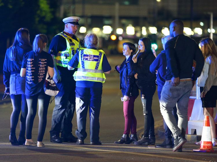 Police and fans close to the Manchester Arena