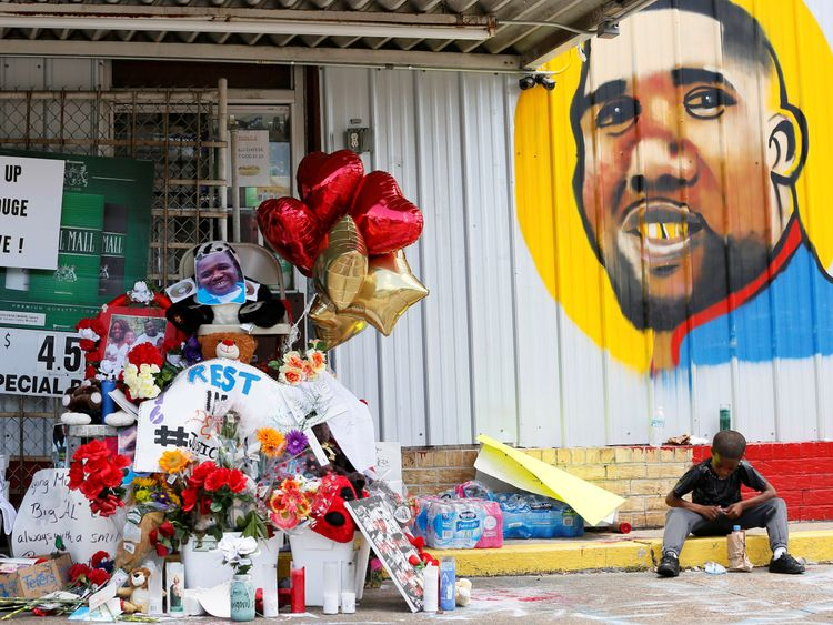 A makeshift memorial outside the convenience store where Alton Sterling was fatally shot by police in Baton Rouge