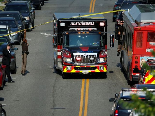 Police make way for an ambulance after a gunman opened fire on Republican members of Congress during a baseball practice in Alexandria, Virginia