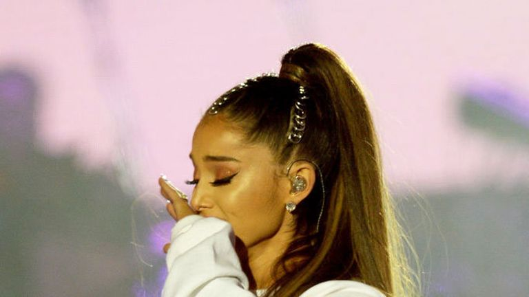 Ariana Grande performs on stage