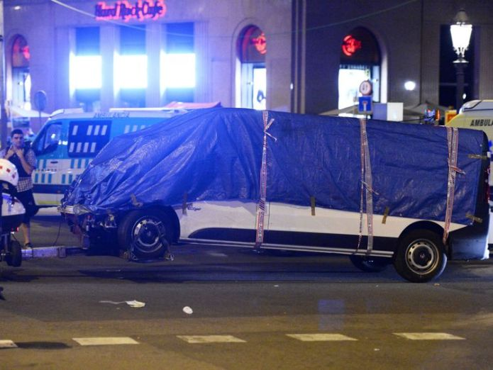 The van who ploughed into the crowd, killing at least 13 people and injuring around 100 others is towed away from the Rambla in Barcelona Did Barcelona and Cambrils attackers plan deadlier rampage? Did Barcelona and Cambrils attackers plan deadlier rampage? 0628c0dc8c70d80f541b8f2fc591124fdfd907b32935f5b9ca0e0e578ec63811 4076350