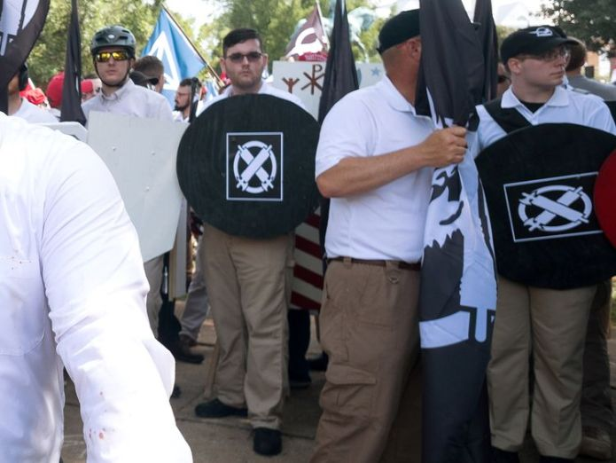 James Alex Fields JR (C) takes part in the rally in Charlottesville before he was arrested May and Merkel condemn 'repulsive' far-right protests in Charlottesville May and Merkel condemn 'repulsive' far-right protests in Charlottesville 23c9764ebc7bd15965b760cca16e8fcf6edf2fbe98b28a11b844d611aea167c2 4073571