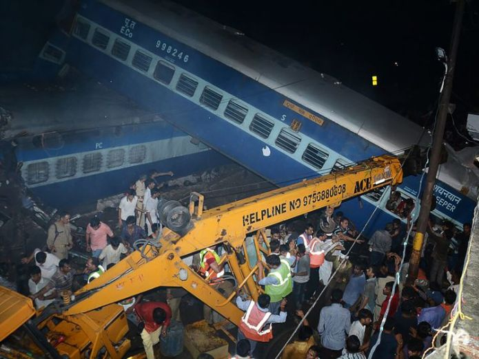 Emergency workers look for survivors on the wreckage of a train carriage after an express train derailed near the town of Khatauli in the Indian state of Uttar Pradesh on August 19, 2017 Train derailment in India kills more than 20 Train derailment in India kills more than 20 6883d9b5a39a31aa9a73a75d64e8e6ae0ed10f0c6a12a123ad1711d02b524d76 4078186