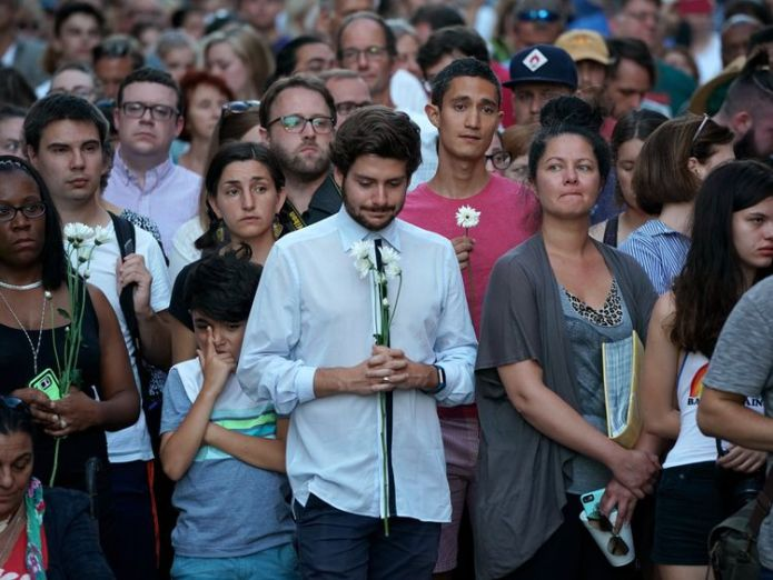 Hundreds of people gather at an informal memorial on the spot where 32-year-old Heather Heyer was killed when a car plowed into a crowd of people protesting against the white supremacist Unite the Right rally August 13, 2017 in Charlottesville, Virginia US emerges from violent weekend in Charlottesville US emerges from violent weekend in Charlottesville 971b7726f97d28f2c237677543f12a633ff53c8e80fcd906c3852c1291b5f831 4073318