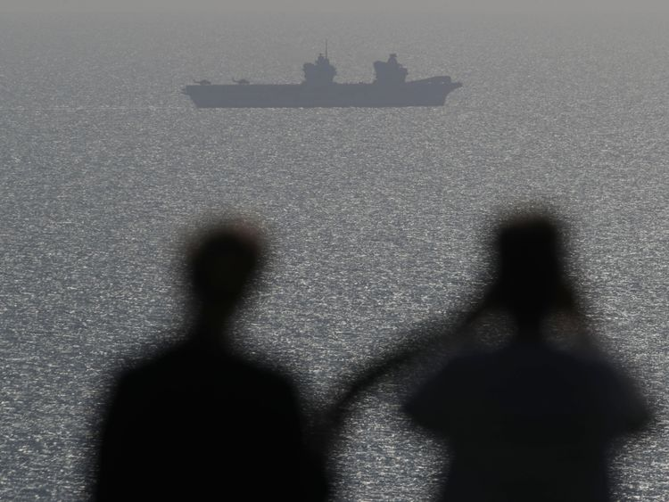 HMS Queen Elizabeth off the coast of the Isle of Wight ahead