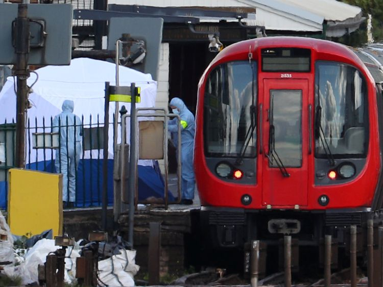 Forensic investigators search on the platform at Parsons Green tube station