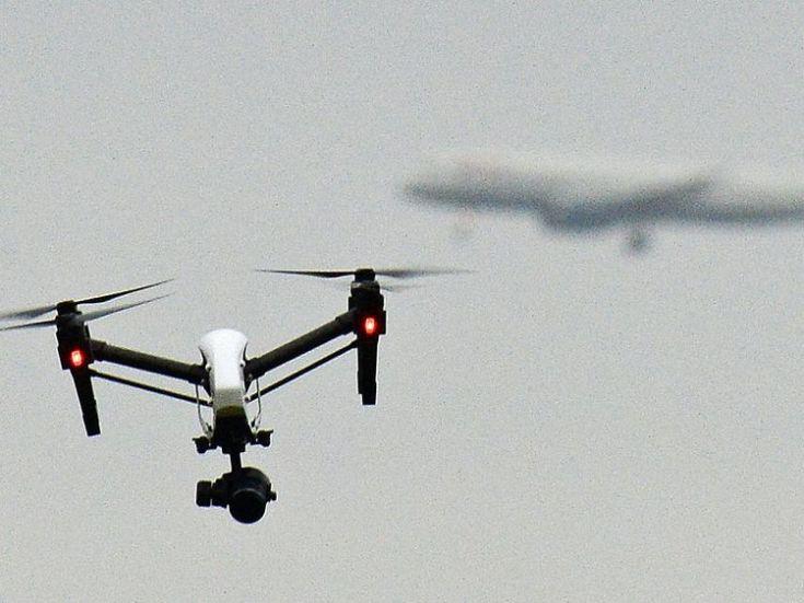 A drone flies near Heathrow. File pic