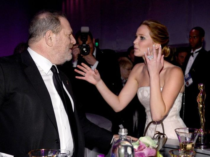 Harvey Weinstein, the executive producer of Silver Linings Playbook, with  Jennifer Lawrence and the Best Actress Oscar she won for the film