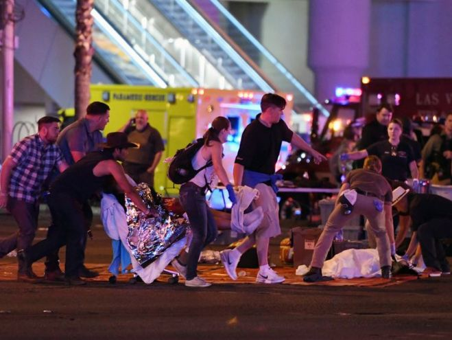 An injured person is tended to in the intersection of Tropicana Ave. and Las Vegas Boulevard