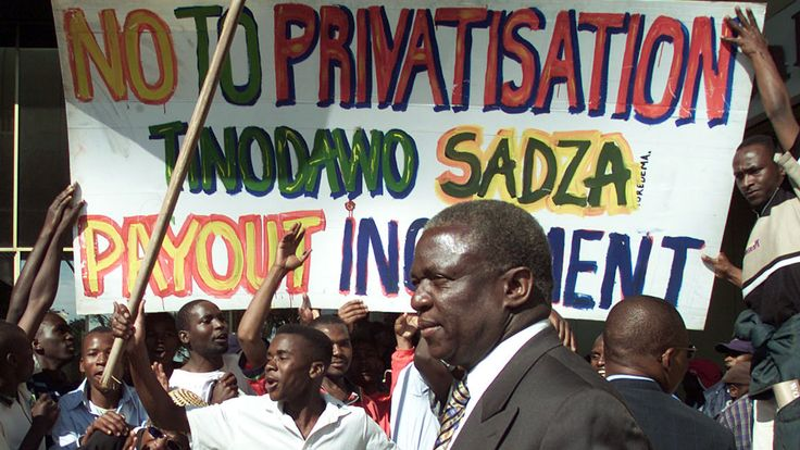 Emmerson Mnangagwa attends a demonstration as justice minister in 2000