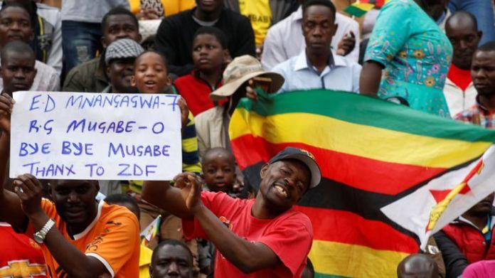People wait for the inauguration ceremony of Zimbabwe's next president Emmerson Mnangagwa  A modern history of a nation skynews mnangagwa zimbabwe 4164678