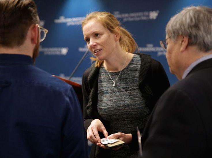Facebook Head of Policy Managment Monika Bickert (C) speaks with audience members following a discussion session about 'Internet Security and Privacy in the Age of Islamic State' at the Washington Institute for Near East Policy February 26, 2016 in Washington, DC