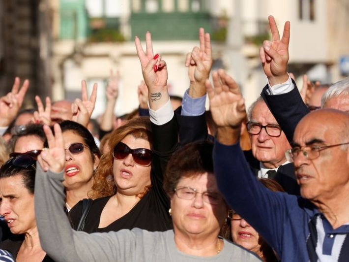People sang the Maltese national anthem and made the peace sign