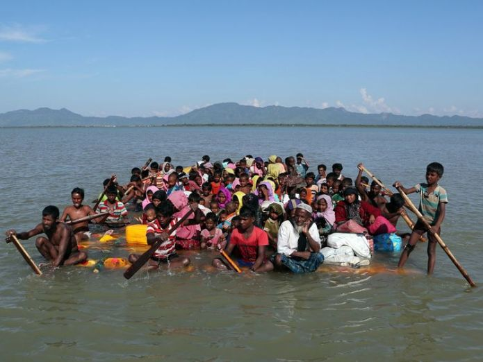 Rohingya refugees use a makeshift raft to reach Bangladesh