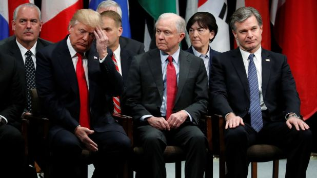 U.S. President Donald Trump, Attorney General Jeff Sessions (2nd R) and FBI Director Christopher Wray (R) in a graduation ceremony