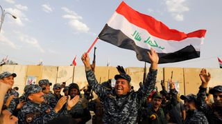 A member of Iraqi Federal Police waves an Iraqi flag as they celebrate victory of military operations against the Islamic State militants in West Mosul, Iraq July 2,  Iraq sees lowest election turnout for 15 years with just 44.5% casting vote Iraq sees lowest election turnout for 15 years with just 44.5% casting vote skynews iraq mosul islamic state 4178280