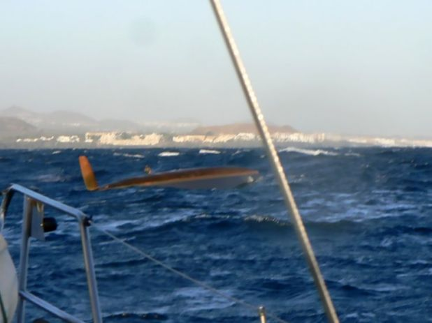 The capsized boat as seen from the St Barbara V. Pic: CEN
