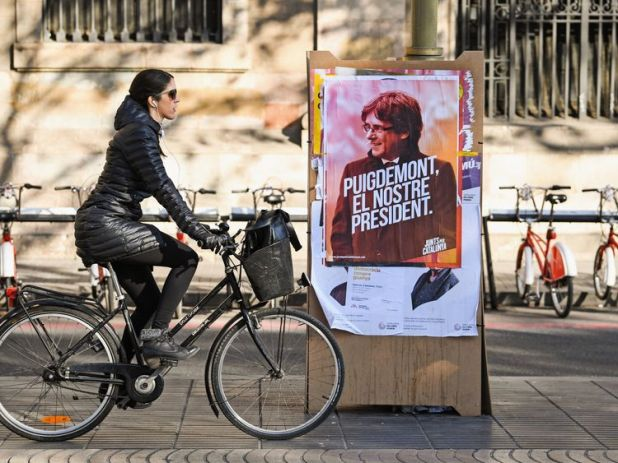 Add to Board Barcelona Braced For Catalan Elections BARCELONA, SPAIN - DECEMBER 20: A member of the public cycles past an election poster for the forthcoming Catalan regional election showing the deposed Catalan president Carles Puigdemont on December 19, 2017 in Barcelona, Spain. Catalonians will head to the polls tomorrow, in an election set to replace or re-elect the deposed separatist leaders whose secession bid plunged Spain into its worst political crisis in decades. (Photo by Jeff J Mitch