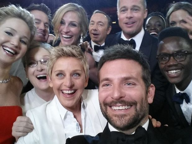 2014 Oscars host Ellen DeGeneres poses for a selfie taken by Bradley Cooper with (clockwise from L-R) Jared Leto, Jennifer Lawrence, Channing Tatum, Meryl Streep, Julia Roberts, Kevin Spacey, Brad Pitt, Lupita Nyong'o, Angelina Jolie, Peter Nyong'o Jr. and Bradley Cooper.
