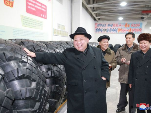 Kim Jong Un inspects tyres at a factory which were used for missile truck