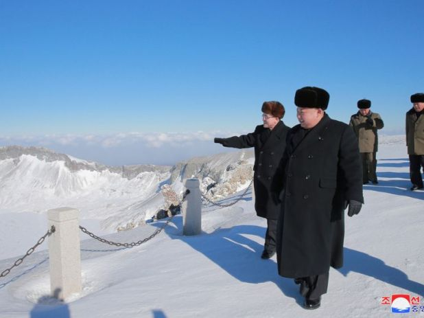 The leader wrapped up in the snowy conditions on Mount Paektu