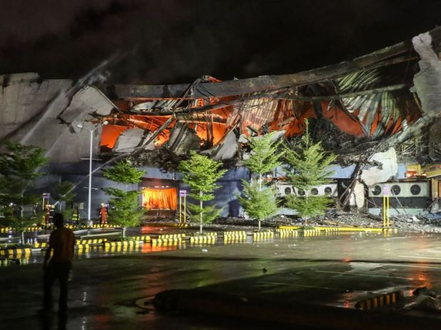 The fire crumpled the four-storey shopping mall
