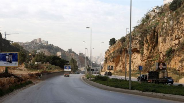 Cars pass near the area where Ms Dykes' body is believed to have been found outside Beirut
